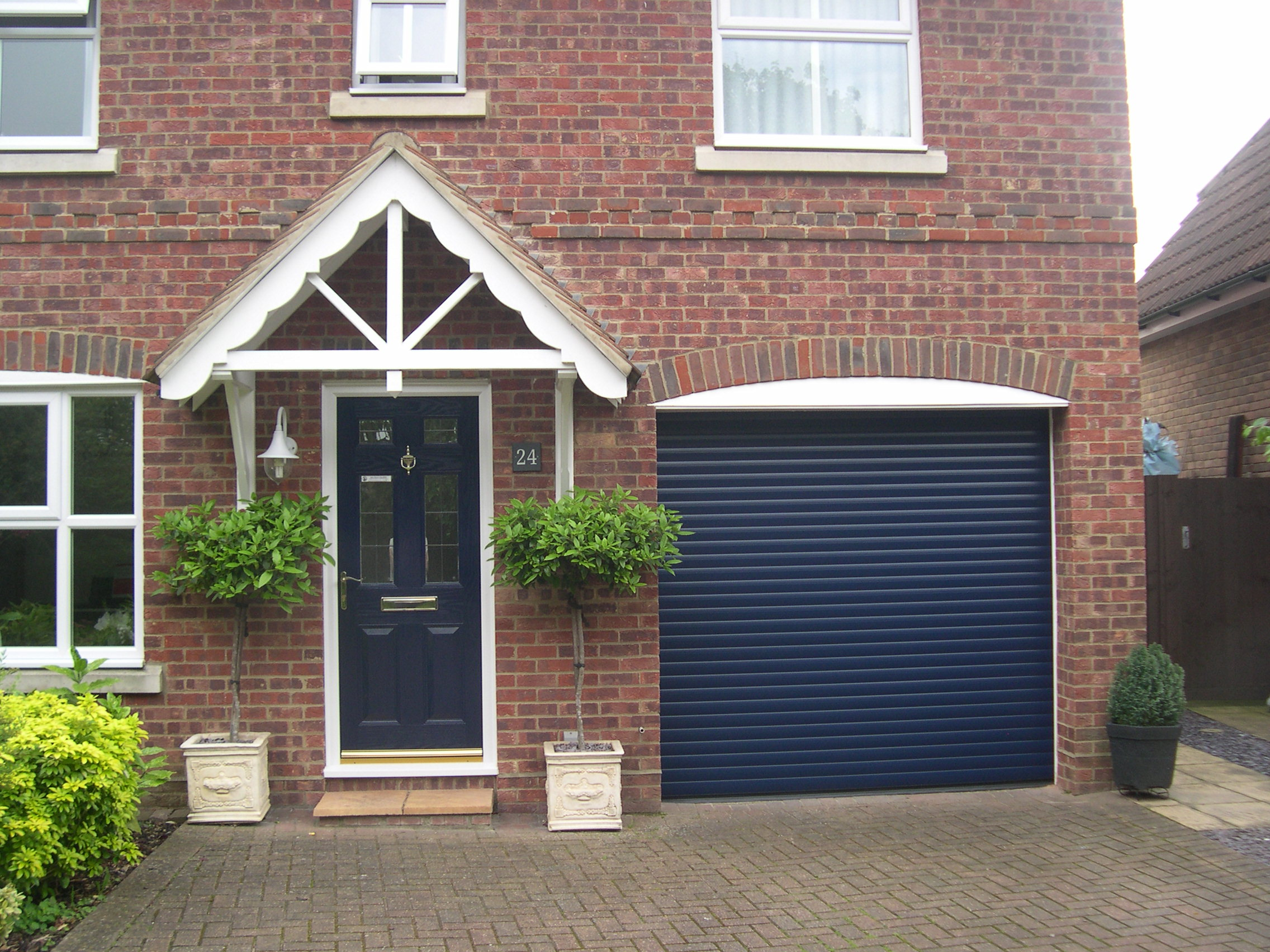 fitted modern  posite front door with matching roller garage door